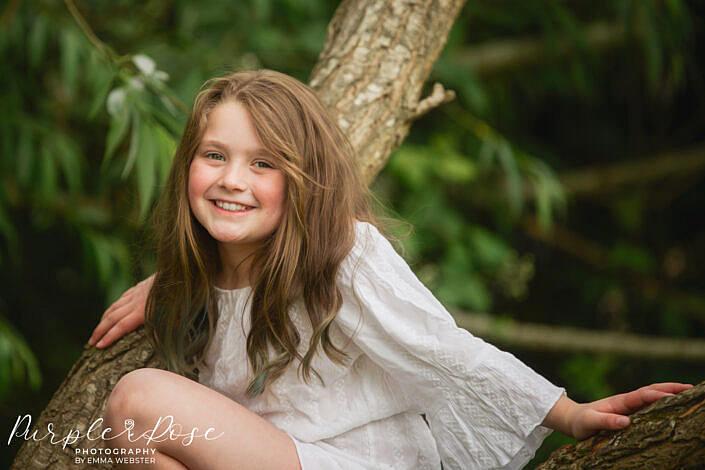 Girl sat in a tree