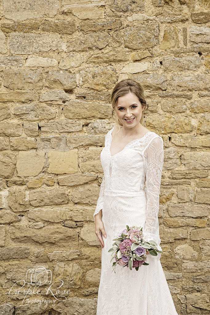 Bride standing outside the barn