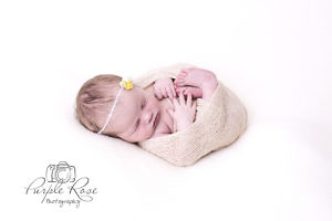 Newborn baby girl all wrapped up for her photshoot