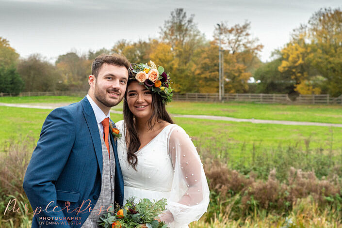 Bride and groom smiling on a winters day