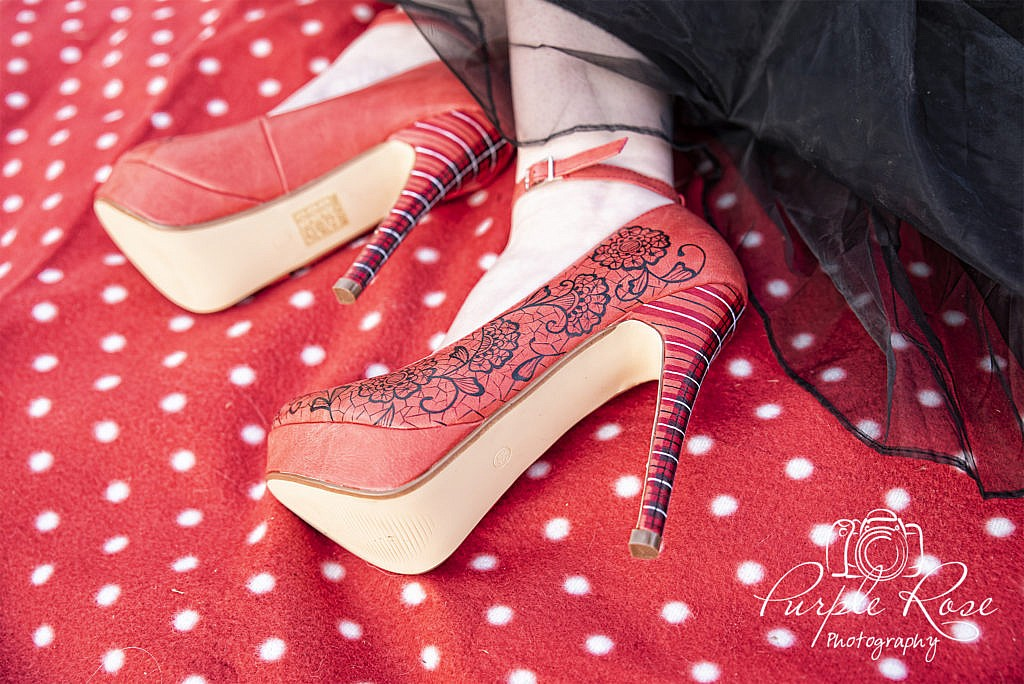 Red hand painted brides shoes