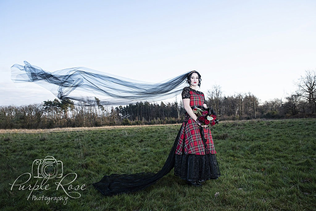 Gothic bride with black wedding veil