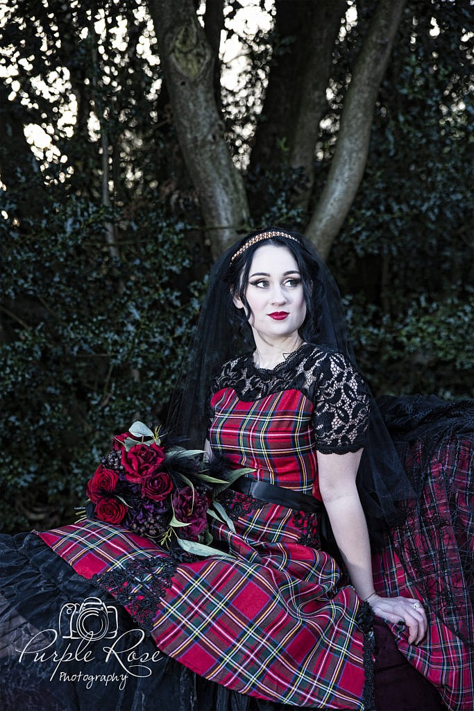 Gothic bride wearing red tartan dress
