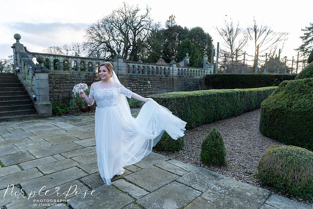 Bride twirling her wedding dress