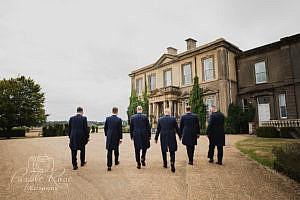 Groomsmen arriving at wedding venue