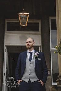 Groom standing in doorway