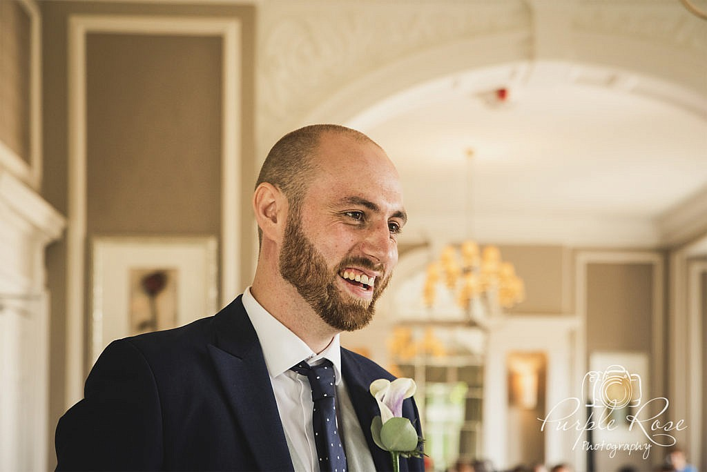 Groom nervously laughing