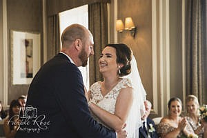 Bride and groom laughing during wedding ceremony