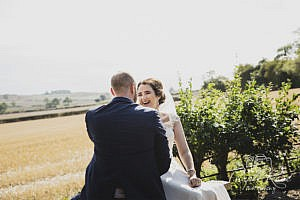 Bride and groom laughing together