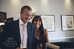 Smiling wedding guests