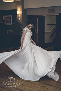 Bride twirling in her wedding dress