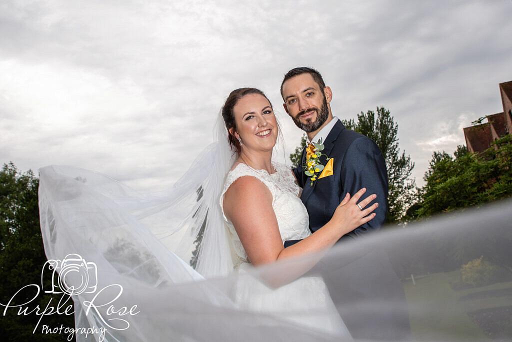 Brdiies veil swishing round the couple