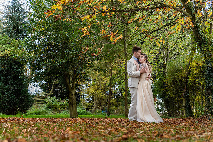 Bride and groom outside in autumn