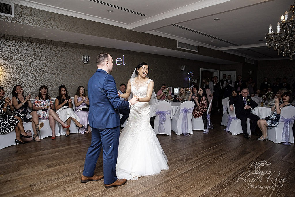Bride and groom enjoying their first dance together as man and wife