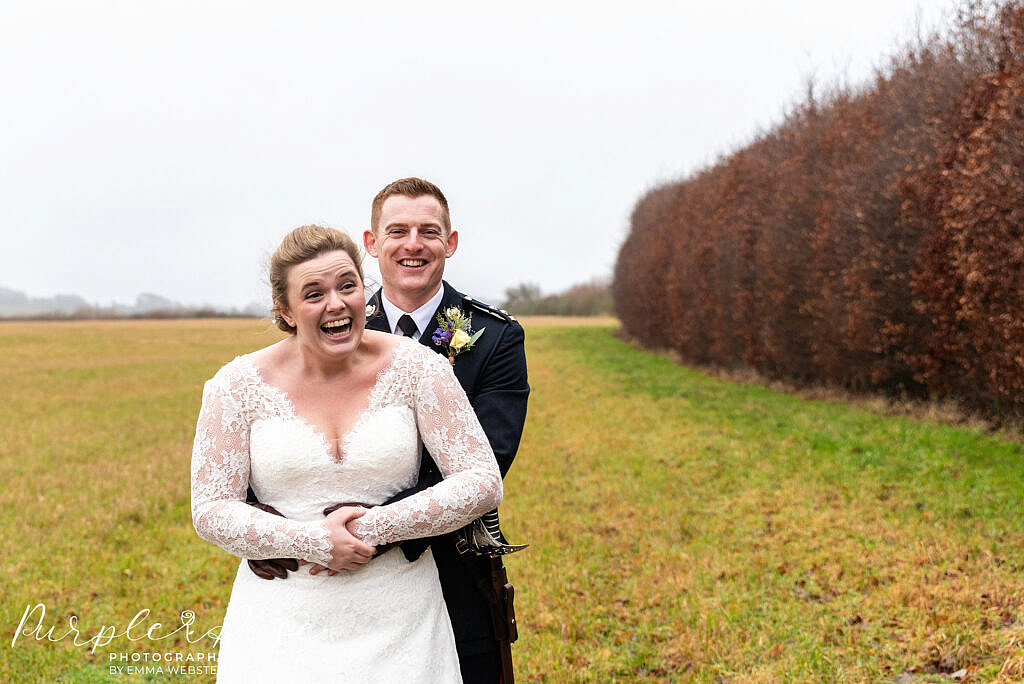 Bride laughing with her groom