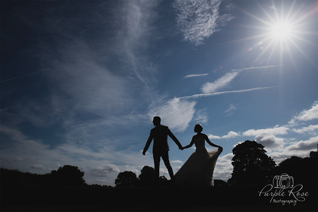 Silhouette of bride and groom on a wall