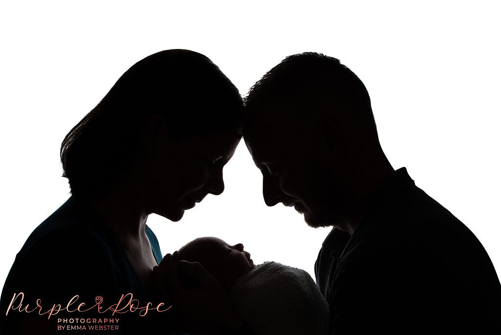 Silhouette of mum, dad and baby