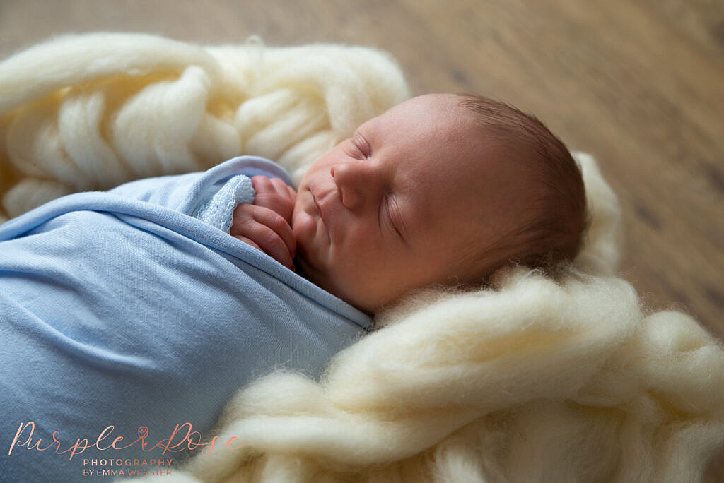 Newborn baby sleeping on fluffy layer