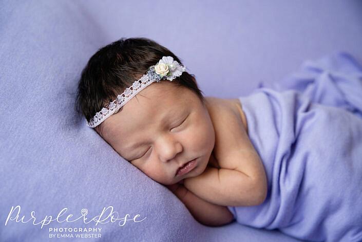 Newborn baby sleeping on her side