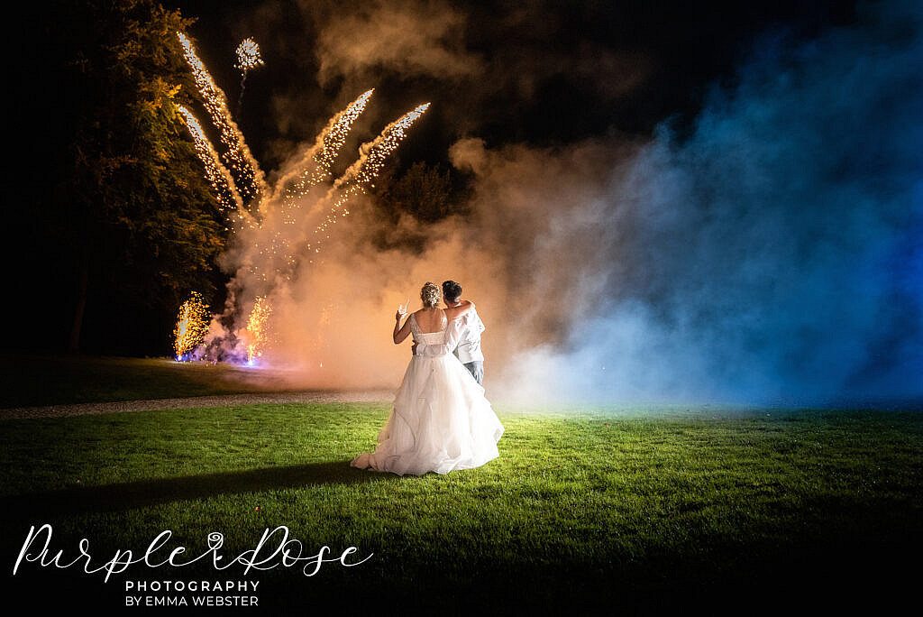 Bride and groom watching fire works