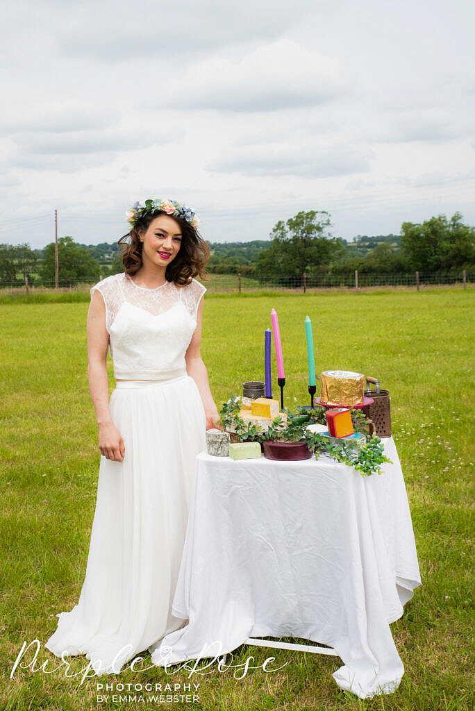 Bride standing by her cheese platter