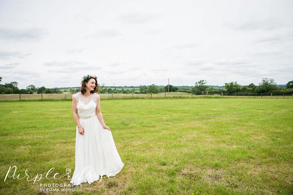 Bride holding her wedding dress