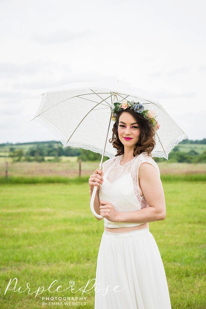 Bride holding an umbrella