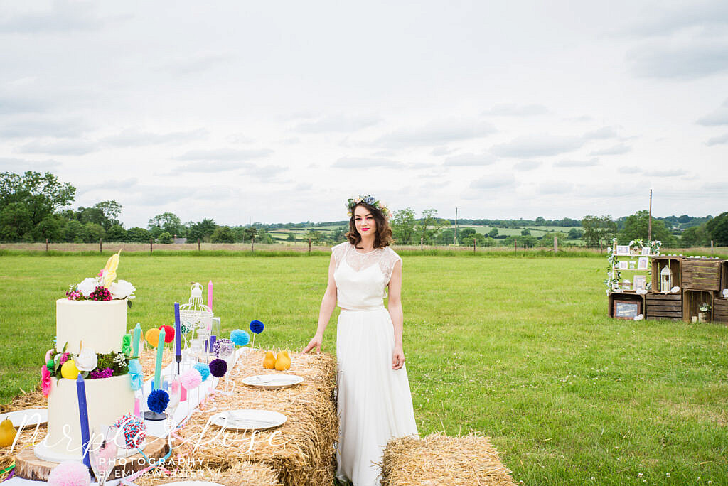 bride standing by wedding table