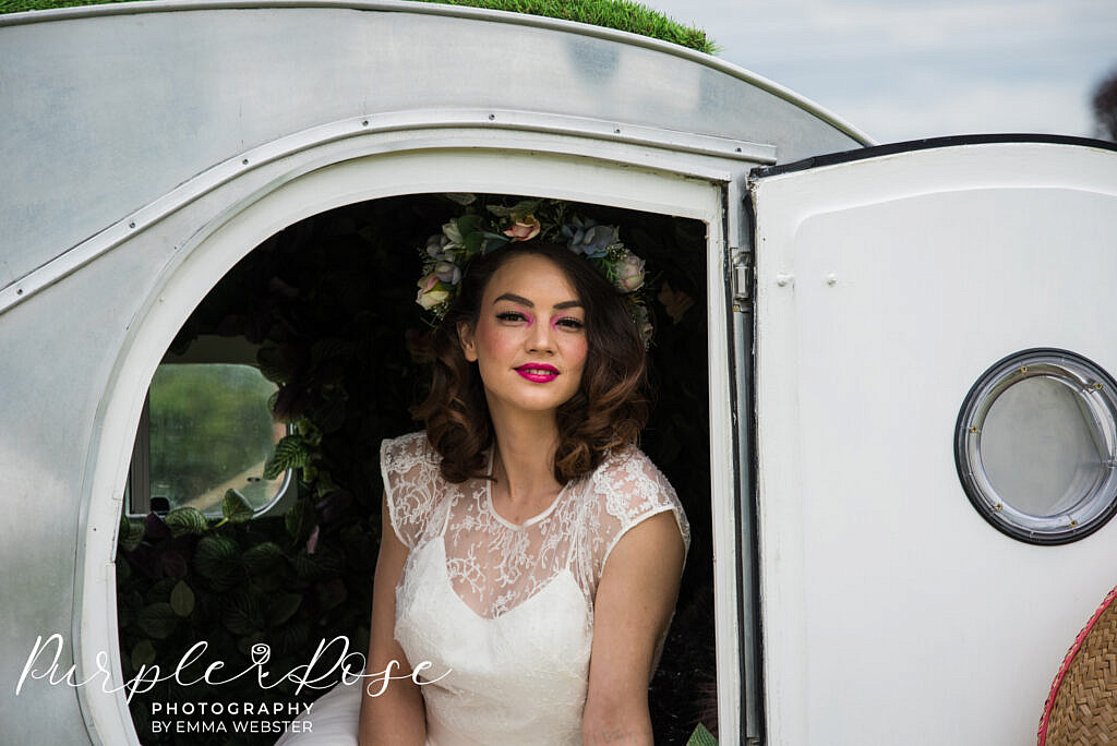 Bride looking out a door