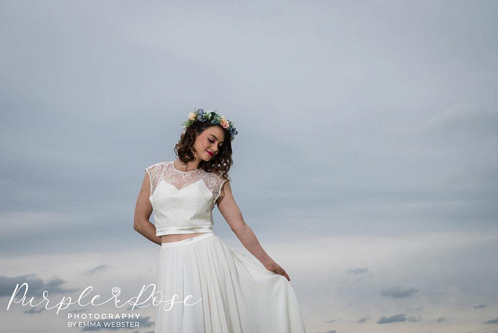 bride in front of a dark sky