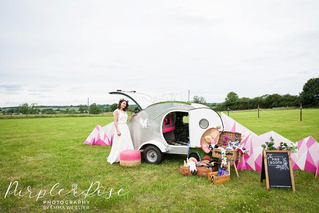 Bride with a photo booth camper van