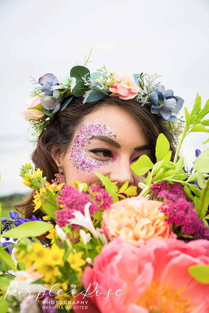 bride hiding behind bouquet