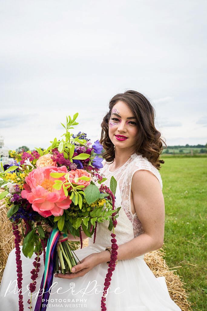 Bride sitting in a field