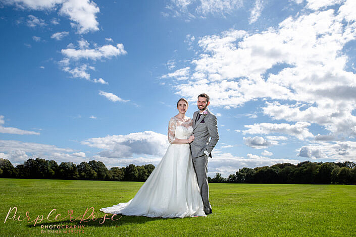 Couple on their wedding day in a field