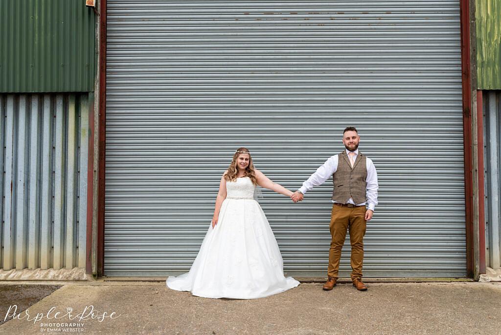 Couple in front of a barn door