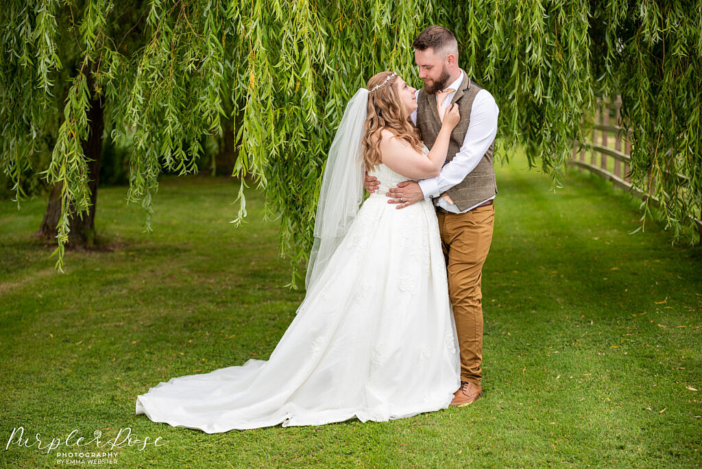 Couple beneath a weeping willow tree