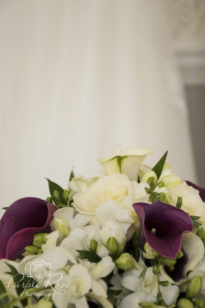 Bridal bouquet with wedding dress in the background