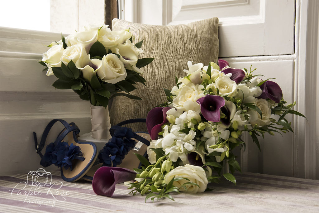 Photo of brides bouquet, brides maids bouquet and brides shoes.