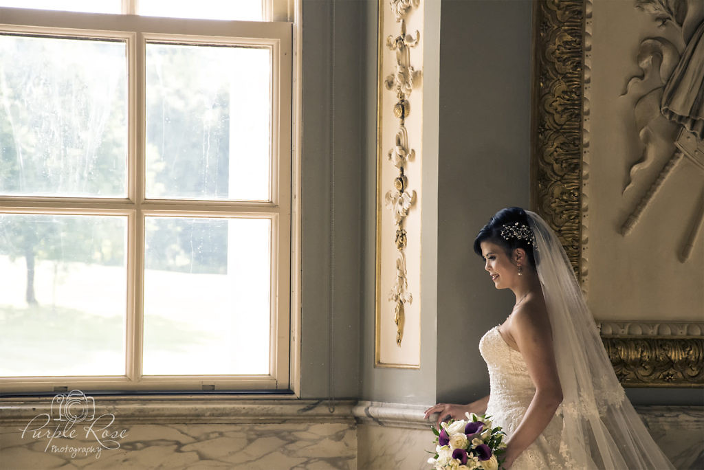 Bride looking out a window