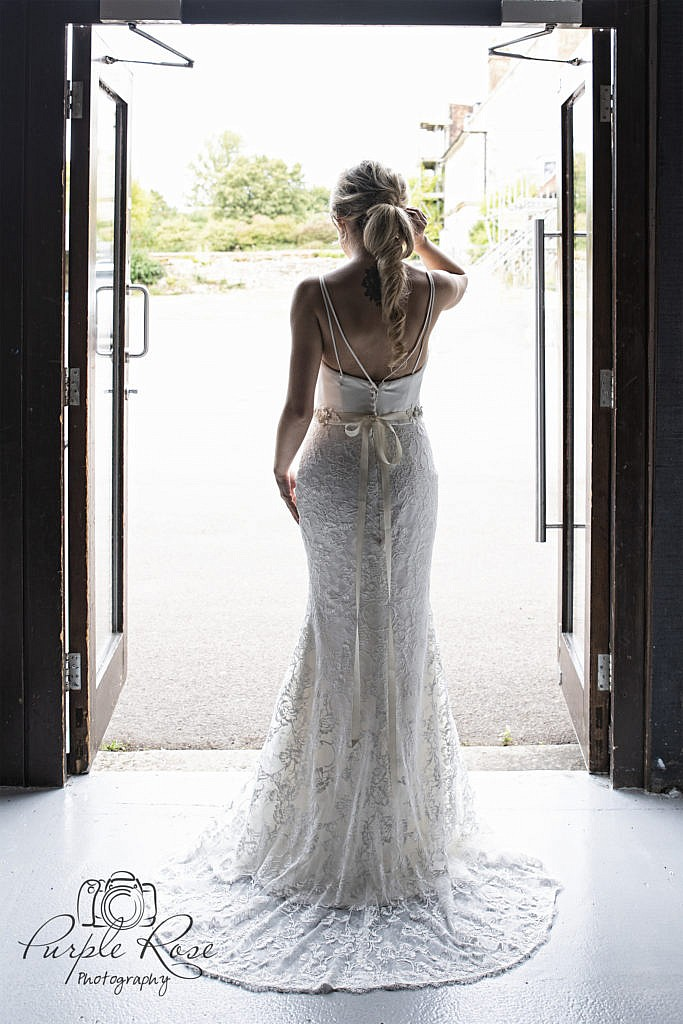 Detailing of the back of a brides dress