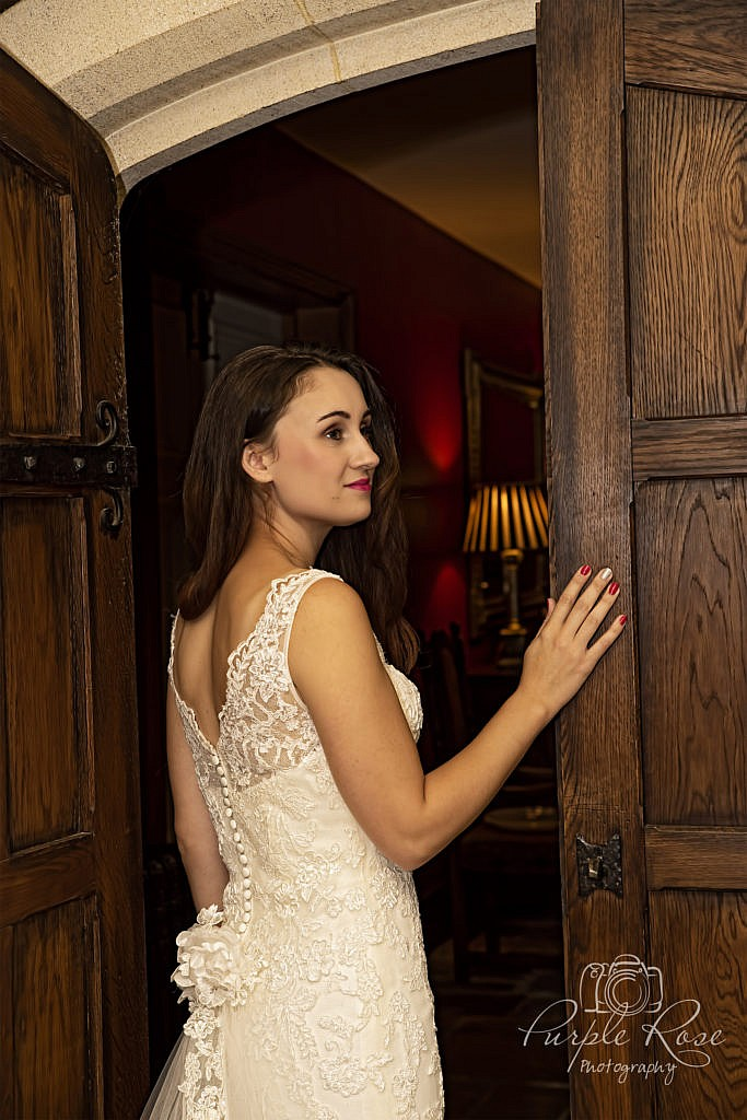 Bride standing by a door
