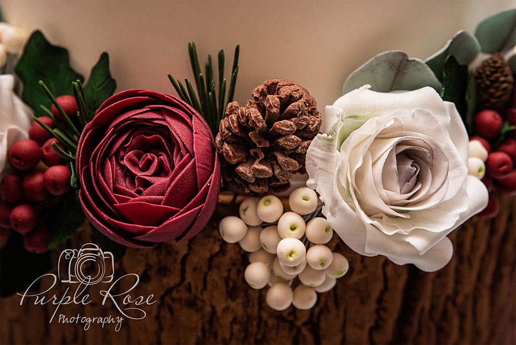 Details of a Christmas themed wedding cake
