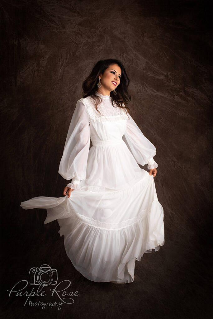 bride dancing in vintage wedding dress