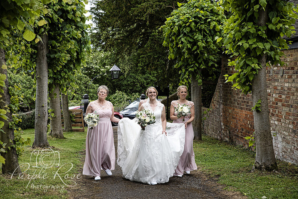 Bride and Bridesmaids walking to the church