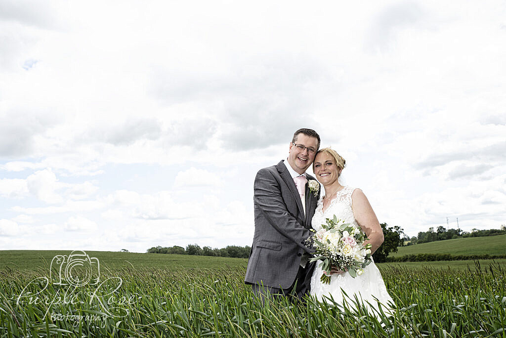 Bride and groom surrounded by crops