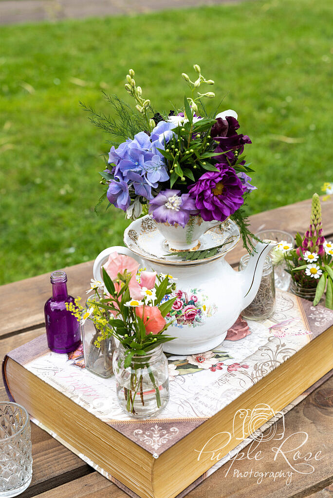 Flowers displayed on a tea pot
