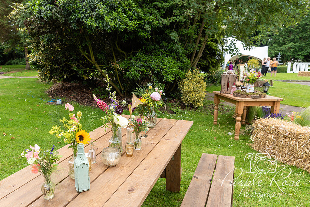 Wooden table with floral display