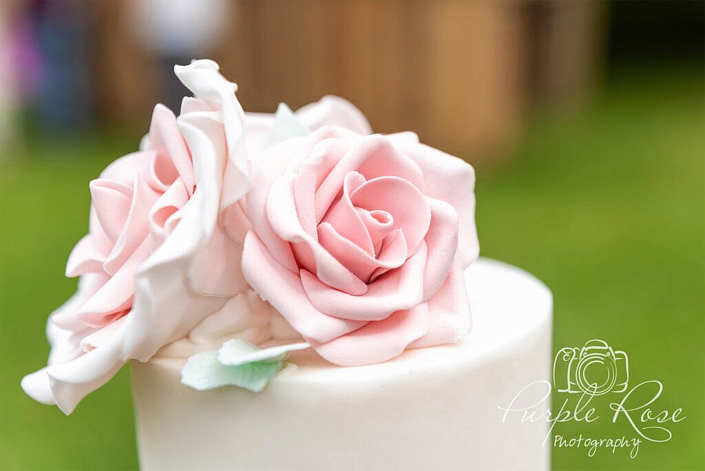 Intricate pink floral cake topper