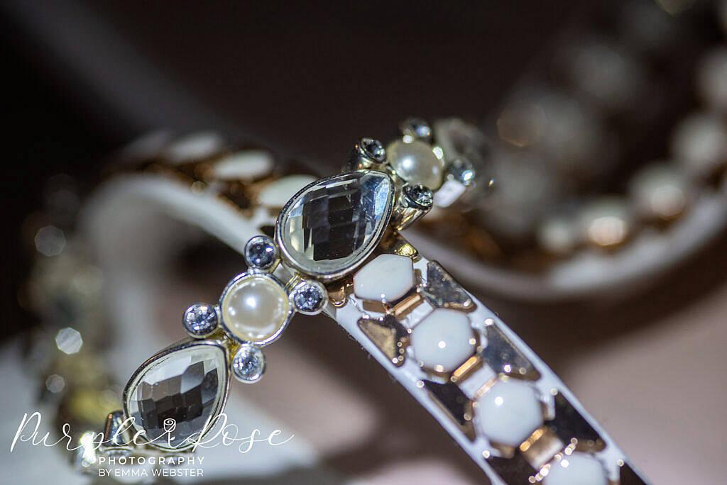 Detail of a brides shoes and bracelet