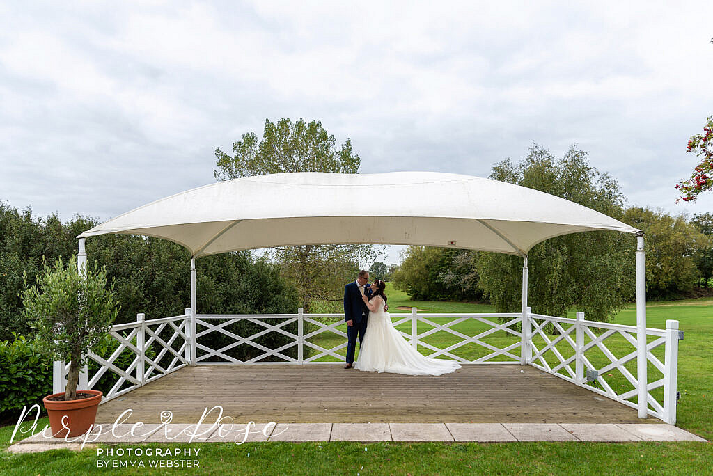 Bride and groom under a canopy